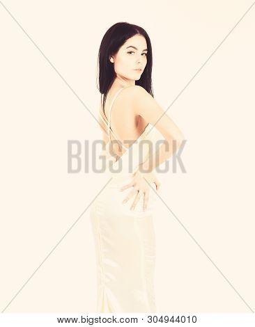 Fashion Wedding Concept. Woman In Elegant White Dress With Nude Back, White Background. Bride, Grace