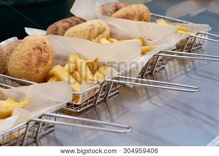 Cooking French Fries. Closeup View Of Making French Fries Deep Frying In Fast Food. The Concept Of F