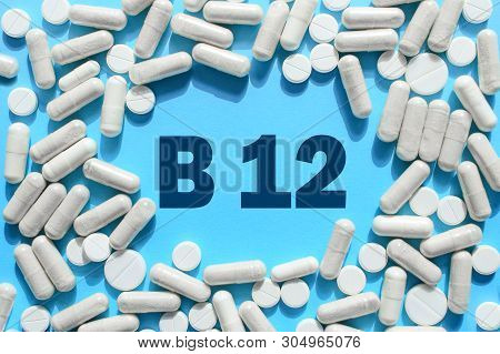 Vitamin B12 Text In White Capsules Frame On Blue Background. Pill With Cobalamin. Dietary Supplement
