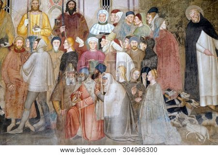 FLORENCE, ITALY - JANUARY 10, 2019: Figures of clergy and laity, detail of the Active and Triumphant Church, Spanish Chapel in Santa Maria Novella Principal Dominican church in Florence, Italy