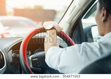 Car Driver Hands Holding Steering Wheel On Road