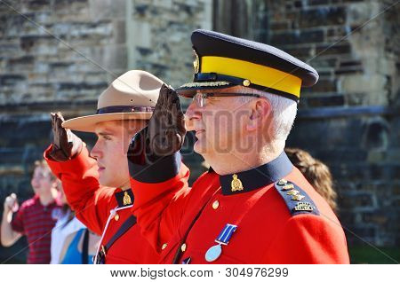Ottawa, Canada - July 1, 2011: Rcmp Police With Antique Red Uniform Solute On Canada Day In The Parl