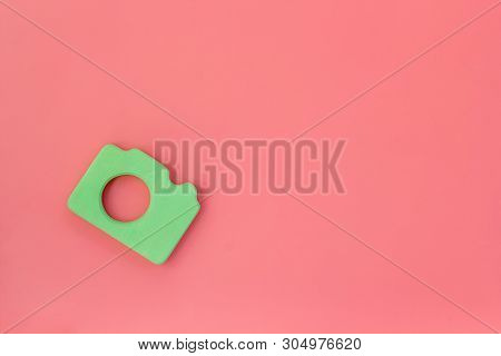 Photo Camera Concept On Pink Background Top View Copy Space