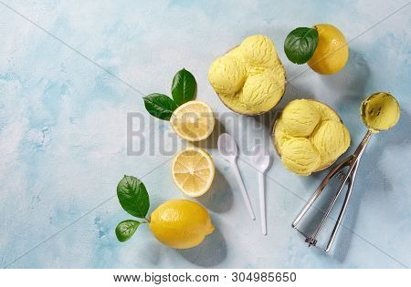 Two Portions Lemon Ice Cream In Paper Cup On Mint Colors Background And A Mettal Spoon Waiting For F