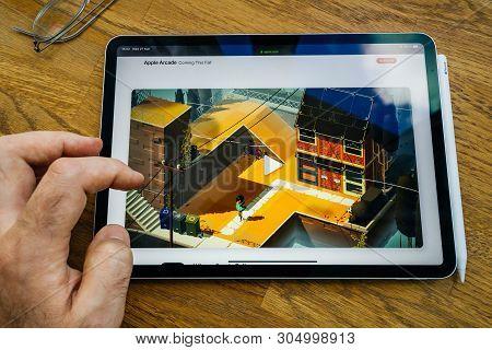 Paris, France - Mar 27, 2019: Pov Personal Perspective On Apple Arcade Webpage Seen On Modern Ipad P