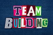 TEAM BUILDING text word collage in colorful fabric on blue denim, growth and cohesion, horizontal aspect poster