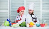 Reasons why couples cooking together. Cooking with your spouse can strengthen relationships. Ultimate cooking challenge. Couple compete in culinary arts. Woman and bearded man culinary partners poster