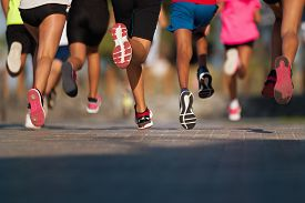 Running Children, Young Athletes Run In A Kids Run Race,running On City Road Detail On Legs,running