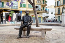 Malaga, Spain - May 24, 2019: Bronze Statue Of Famous Painter And Sculptor Pablo Picasso. It Was Mad
