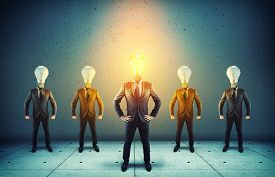 Group Of Businessman With Lightbulbs Instead Of Head.elite Business Team .out Of The Box Concept.