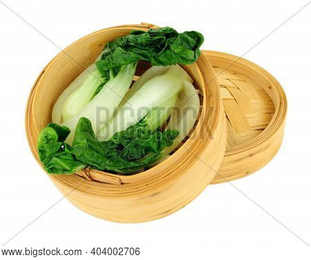 Freshly Steamed Pak Choi Chinese Cabbages In A Bamboo Steamer Isolated On A White Background
