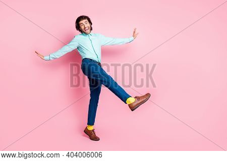 Full Body Photo Of Crazy Energetic Brown Hair Man Have Fun Crazy Go Walk Isolated Over Pink Color Ba