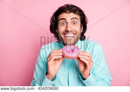 Photo Of Excited Funny Guy Hold Colorful Donut Cake Taste Dessert Sugary Addiction Concept Isolated