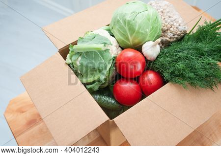 Contactless Product Delivery By The Door. Food Donation Package Vegetables To Help The Sick Or Poor.