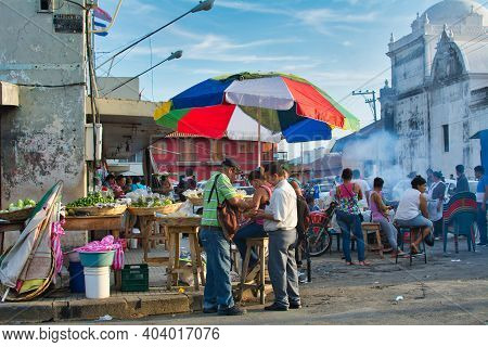 Market At Calle Ruben Dario In Leon, Nicaragua With Cathedral In The Background
