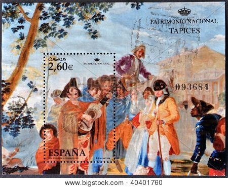 A stamp printed in Spain shows the tapestry entitled The Blind Man of the guitar work of Goya held