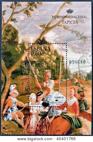 stamp printed in Spain shows the tapestry entitled The Swing work of Goya held at the Royal Tapestry