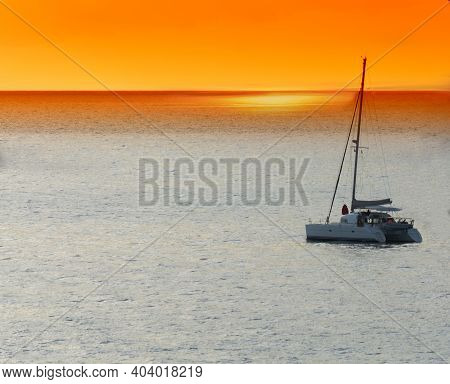 Yacht - Catamaran In The Tropical Sea At Sunset. Yachting / Luxury Sailing Theme