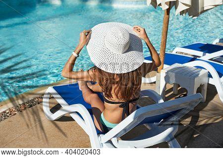 Beautiful Woman Sunbathing On A Beach At Tropical Travel Resort, Enjoying Summer Holidays. Girl Lyin