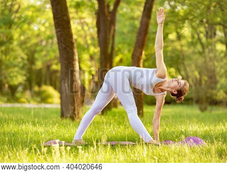 Unity With Nature. Tranquility And Concentration. Finding Inner Peace. Yoga Practice. Adult Woman Pr
