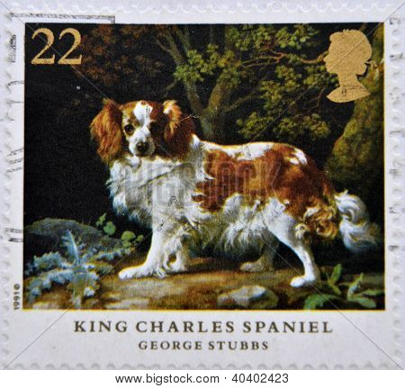 a stamp printed in Great Britain shows King Charles Spaniel painting by George Stubbs
