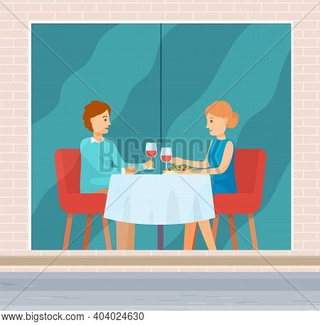 Lovers On A Date In A Restaurant. Married Couple Celebrate The Holiday Together. Man And Woman Sitti