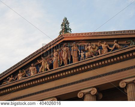 Philadelphia, Usa - June 11, 2019: Several Tourists Posing And Taking Pictures Next To The Rocky Sta
