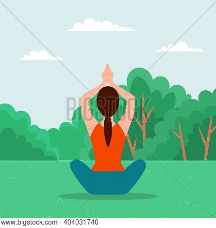 Woman Doing Yoga Exercise Back View. Young Fit Girl Sitting In Lotus Position On The Grass In City P