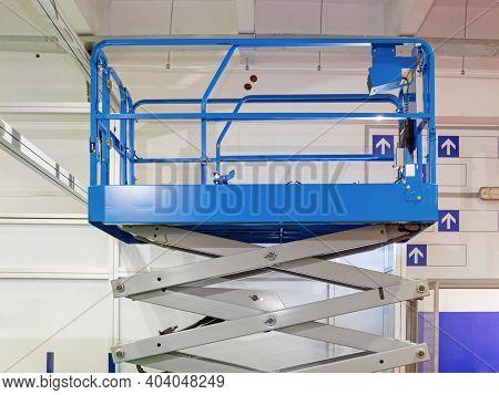 Elevated Work Platform Scissor Lift Inside Building