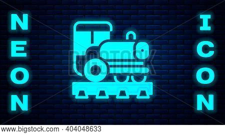 Glowing Neon Vintage Locomotive Icon Isolated On Brick Wall Background. Steam Locomotive. Vector