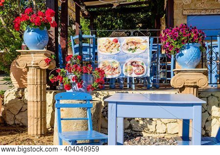 Rhodes Island, Greece - May 19, 2016: Traditional Greek Restaurant (tavern), Decorated With Flowers,