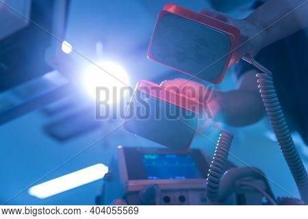 The Doctor Is Giving A Defibrillators To Save The Patient\'s Life In The Hospital. Cpr. Using A Defi