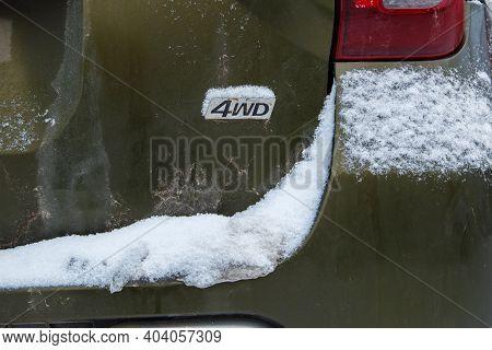 An Abbreviation 4wd - Four-wheel Drive - On Dirty Green Car Back
