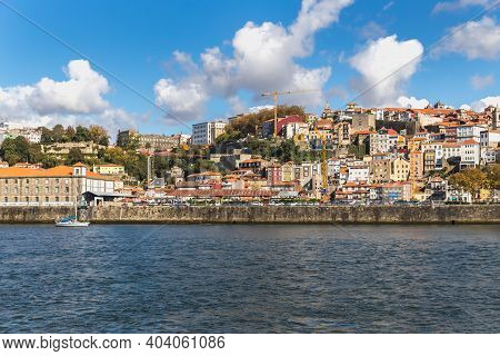 Porto, Portugal - October 23, 2020: View of the buildings with typical architecture and boats of tou