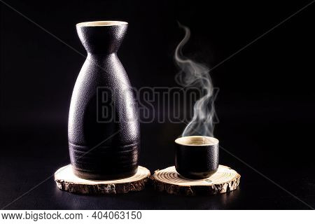 Sake, A Traditional Distilled And Fermented Alcoholic Drink From Japan, Served Hot, Produced From Ri
