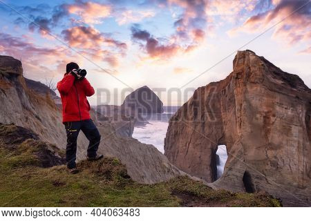 Photographer Is Taking Pictures Of The Beautiful Seaside View On The Oregon Coast. Taken In Cape Kiw