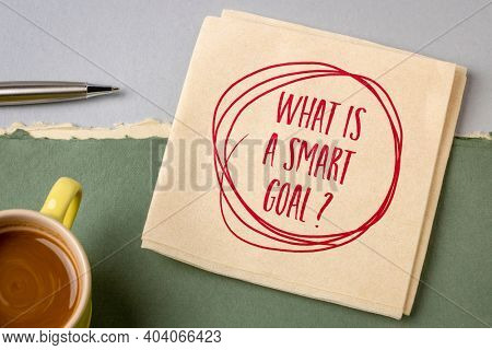 What is a smart goal? Handwriting on a napkin with coffee. Planning and setting goals concept.