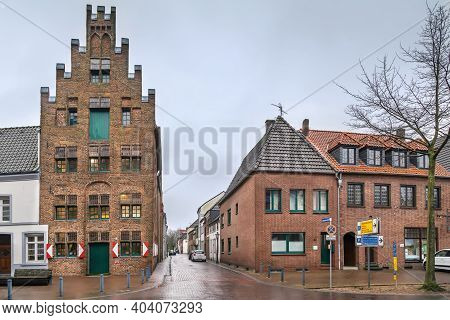 Street In Kalkar With Historical Stepped Gable House From 1500, Germany
