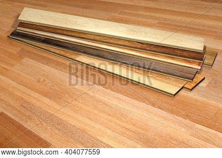 New parquet planks of different colors with different wood species on wooden floor. Copy space for text. 3d render