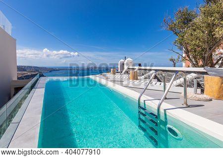 Luxurious Swimming Pool In Santorini Island Greece. Swimming Pool With A View On Caldera Over Aegean