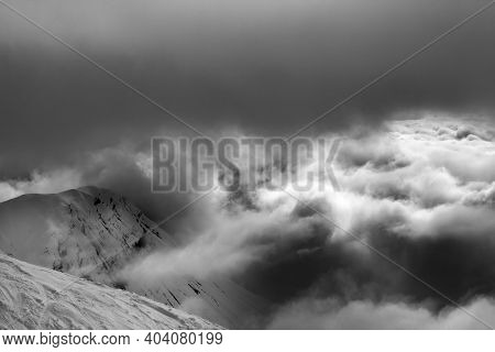 Off-piste Slope And Snowy Rocks In Bad Weather Before Snow Blizzard. Georgia, Region Gudauri In Wint