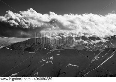 Evening Snowy Mountains And Sunlight Clouds At Winter Evening. Caucasus Mountains, Georgia, Region G
