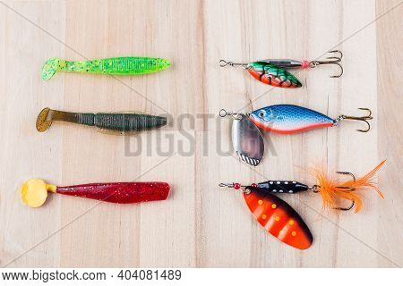 Various Fishing Accessories, Silicone Jig And Metal Spoon, And  On A Wooden Background, 23 November