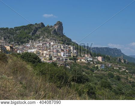 Cityscape Of Old Pictoresque Village Ulassai With Limestone Climbing Rock And Green Vegetation And M