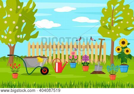 Spring Landscape In The Garden With Green Grass, Flowers, Garden Wheelbarrow, Shovel. Garden Concept