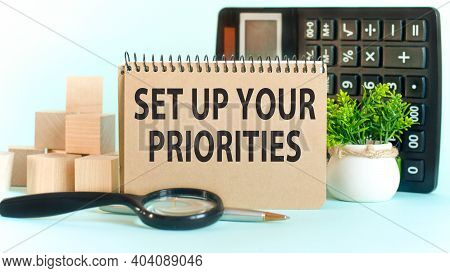 Business Concept. Notebook With Text Set Up Your Priorities Sheet Of White Paper For Notes, Calculat