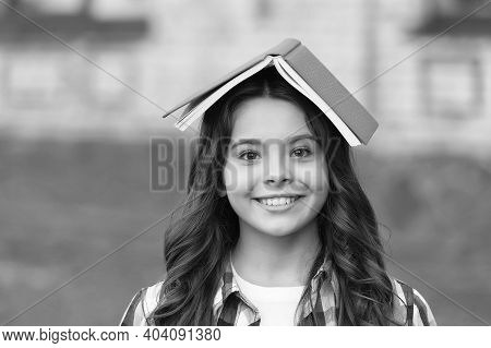 Enriching Life With Knowledge. Happy Child Hold Book On Head. Knowledge Day. September 1. Back To Sc