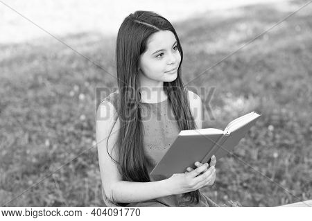 Fly High Into Imagination. Little Child Read Book On Summer Day. Developoing Imagination. Imaginatio
