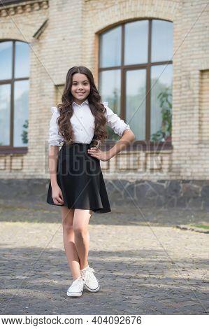 Happy Kid With Long Hair Wear Formal School Fashion Dress Code Schoolyard Outdoors, Uniform.