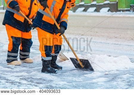 Communal Services Workers Sweep Snow From Road In Winter, Cleaning City Streets And Roads During Sno